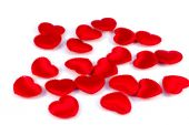 Several small red hearts tissue on a white background — Stock Photo
