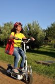 Modern woman moves with electric scooter Monopattino, segway. — Stock Photo