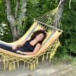 Mature woman relaxes on a hammock. — Stock Photo #60212241