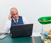 A business man on the phone and pc, at desk, in conference call — Stock Photo