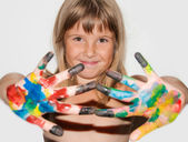 Girl with painted fingers — Stock Photo