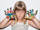 Child girl with painted fingers — Stock Photo