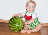 Baby and watermelon — Stock Photo