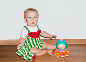 Baby with toy sits — Stock Photo