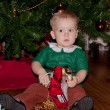 Baby boy under decorated christmas tree — Stock Photo #61329329