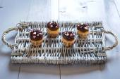 Four delicious chocolate cupcakes on a wicker tray — Стоковое фото
