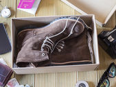 Open box with a pair of boots. Preparing an adventure trip. — Stock Photo