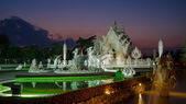 Wat Rong Khun (White temple) at twilight time — Stock Photo