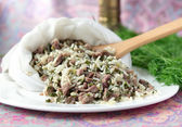 Uzbek traditional dish green pilaf in bag on white plate — Stock Photo