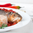 Steamed sea bass in tomato sauce with chili pepper. — Stock Photo #56743905
