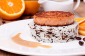 Salmon medallion with mixed cooked rice on white plate — Stock Photo