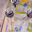 Chocolate Cake pops on the sticks in glass, wooden background — Stock Photo #58372511