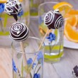 Chocolate Cake pops on the sticks in glass, wooden background — Stock Photo #58372729
