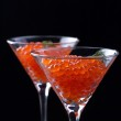 Red caviar in wineglasses on black background — Stock Photo #60766335