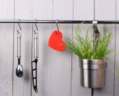 Red heart and kitchen cooking utensil on stainless steel rack. Copy space. — Stock Photo