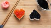 Two heart shaped sushi with salmon roe and beluga caviar — Stock Photo
