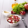 Healthy salad with pomegranate seeds, almond, feta cheese and black rice — Stock Photo #64777023
