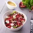 Healthy salad with pomegranate seeds, almond, feta cheese and black rice — Stock Photo #64777047