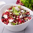 Healthy salad with pomegranate seeds, almond, feta cheese and black rice — Stock Photo #64777227