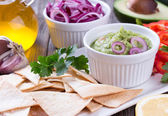 Tortilla Chips nachos, Guacamole and Ingredients — Stock Photo