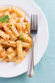 Plate of penne pasta with bread crumbs and basil. — Stock Photo