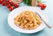 Plate of penne pasta with bread crumbs, basil and cherry tomatoes. — Stock Photo