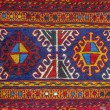 Colorful peruvian fabric style rug surface close up — Stock Photo #62902353