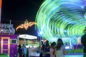 MALAGA, SPAIN - AUGUST, 14: Night lights and fair attractions at the Malaga August Fair on August, 14, 2009 in Malaga, Spain — Stock Photo