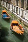 Two boats moored in a canal in Venice Italy — ストック写真