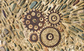 Pavement texture with gears and bricks in Montjuic, Barcelona, S — Stock Photo