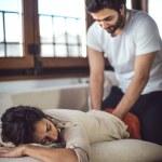 Young couple. Man massaging a woman — Stock Photo #66472159