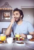 Happy couple having breakfast together — Stock Photo