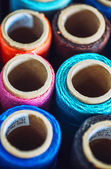 Sewing threads multicolored background closeup texture — Stock Photo