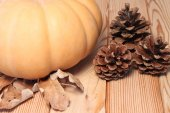 Autumn table, pumpkin and cones on a wooden surface — Stock Photo