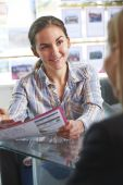 Estate Agent Discussing Property With Client In Office — Stok fotoğraf