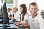 Male Elementary Pupil In Computer Class  — Photo