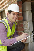Architect Checking Insulation During House Construction — Stock Photo