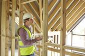 Building Inspector Looking At New Property — Foto Stock