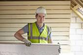 Builder Fitting Insulation Boards To Roof Of New House — Stock Photo