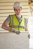 Builder Fitting Insulation Boards Into Roof Of New Home — Stock Photo