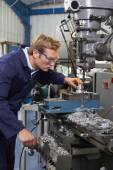 Male Engineer Using Drill In Factory — Stock Photo