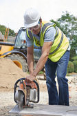 Construction Worker Cutting Stone With Circular Saw — Stock Photo