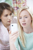 Mother Comforting Daughter Being Bullied By Text Message — Stock Photo