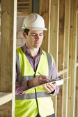 Building Inspector Looking At New Property — Stock fotografie