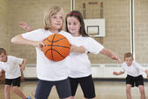 Elementary School Pupils Playing Basketball In Gym — Stock Photo
