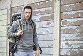 Homeless Teenage Boy On Street With Rucksack — Stock Photo