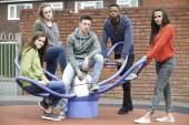 Gang Of Teenagers Hanging Out In Children's Playground — Stock Photo