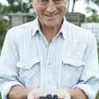 Senior Man On Allotment Holding Freshly Picked Blackberries — Stock Photo #53890339