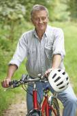 Senior Man Enjoying Cycle Ride In The Countryside — Stock Photo