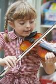 Young Girl At School Learning To Play Violin — Foto de Stock